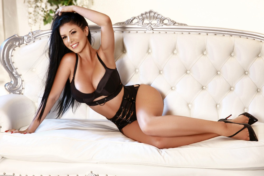 Paddington Escort Fanny, Slim & busty brunette. Wearing BDSM black bra and panties at 24hr London Escorts Agency