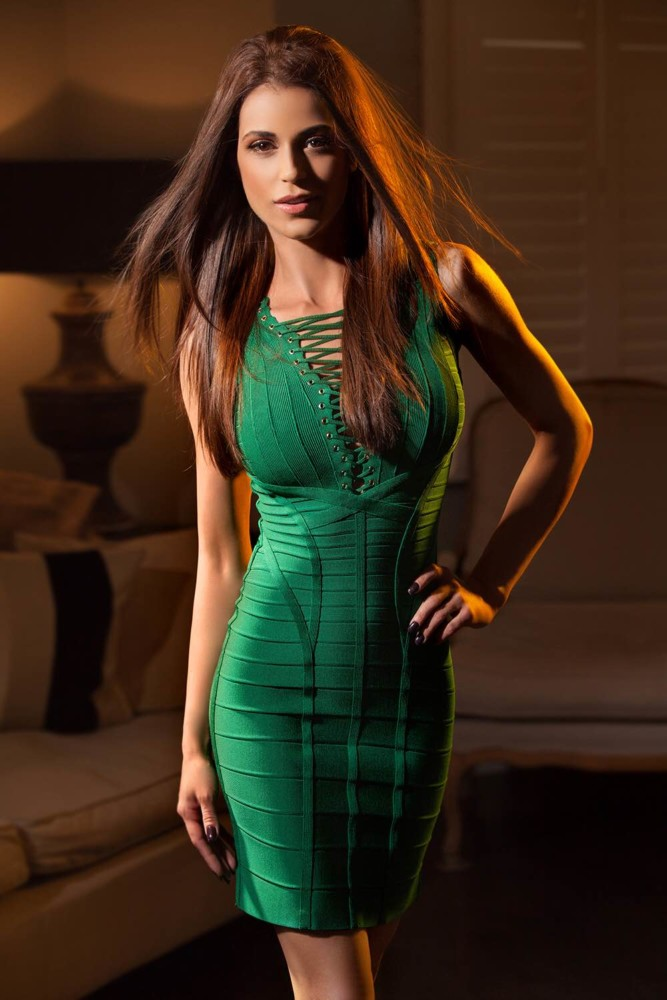 Gloucester Road Escort Cassie. Wearing sexy tight green dress at 24hr London Escorts Agency