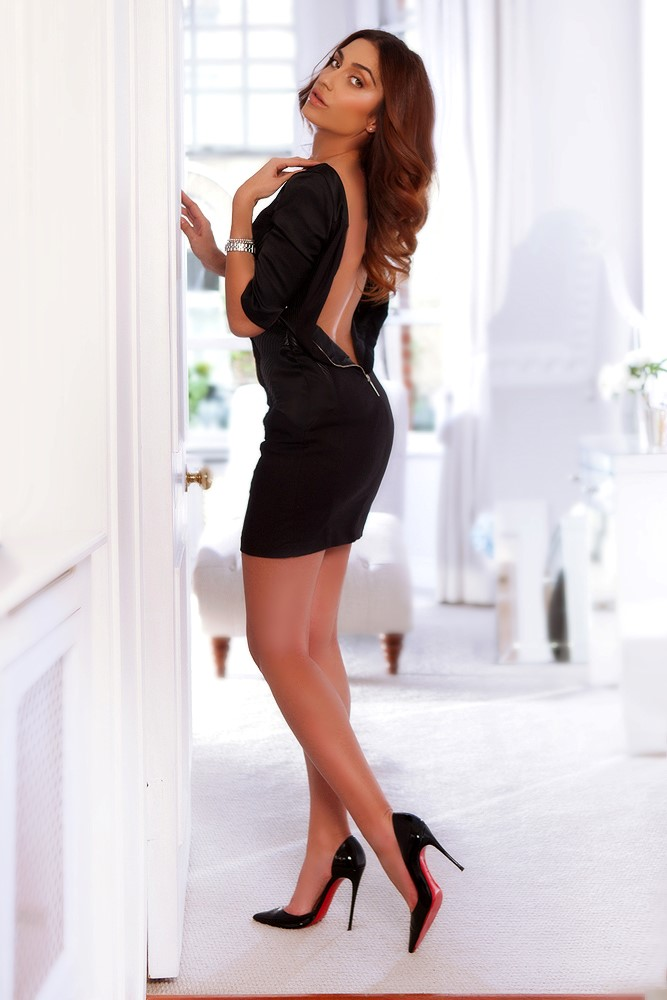 Busty & Slim Paddington Escort Crystal. Wearing Sexy black little dress, bottom shoes at 24hr London Escorts Agency