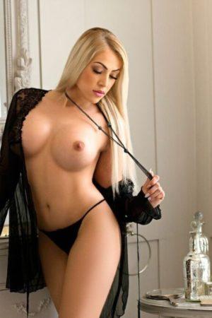 BDSM Marble Arch Escort Denny Blonde Busty & Slim. 34DD. Wearing black lace at 24hr London Escorts Agency
