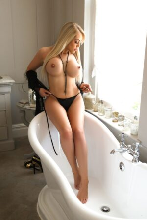 BDSM Marble Arch Escort Denny Blonde Busty & Slim. Topless in the bath at 24hr London Escorts Agency