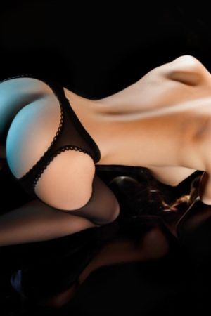Bayswater Escort Eva Slim and Slender blonde. Wearing Red lingerie topless and all fours at 24hr London Escorts Agency