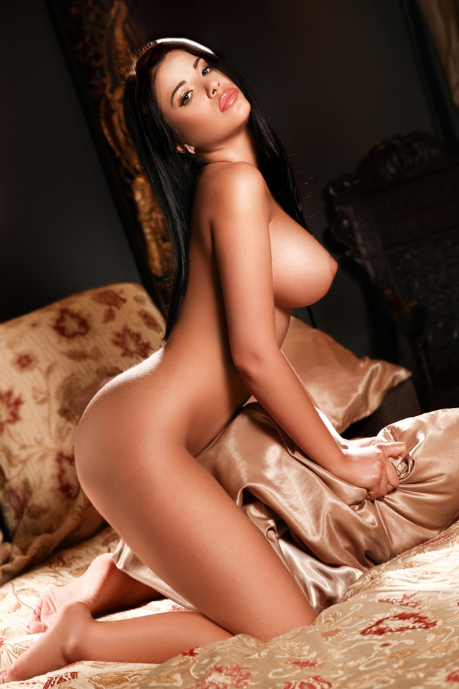 Paddington Escort Fanny, Slim & busty brunette. Wearing her birthday suit, kneeling down, at 24hr London Escorts Agency