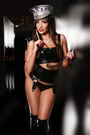 Paddington Escort Katrina. Slim and Slender BDSM Escort. Wearing black leather & latex, at 24hr London Agency