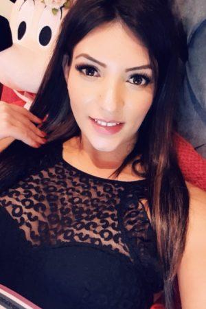 Paddington Escort Katrina. Slim and Slender BDSM Escort. Taking a selfie, at 24hr London Agency
