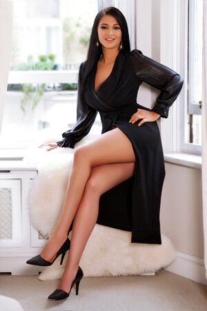 Bayswater Escort Lala looking stunning wearing black long wrap dress, at 24hr London Escorts Agency