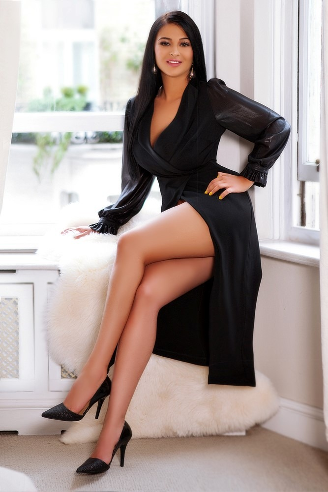 Bayswater Escort Lala looking stunning wearing black long wrap dress, at 24hr London Escorts Agency