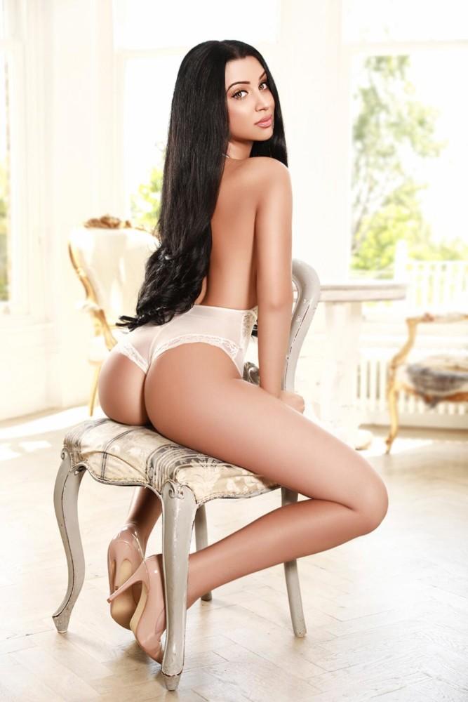 Paddington Escort Layla. Stunning slim and busty model. Wearing lace white lingerie, at 24hr London Escorts Agency