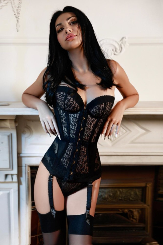 Baker Street Escort Leona Beautiful English Model. Wearing black basque, at 24hr London Escorts Agency