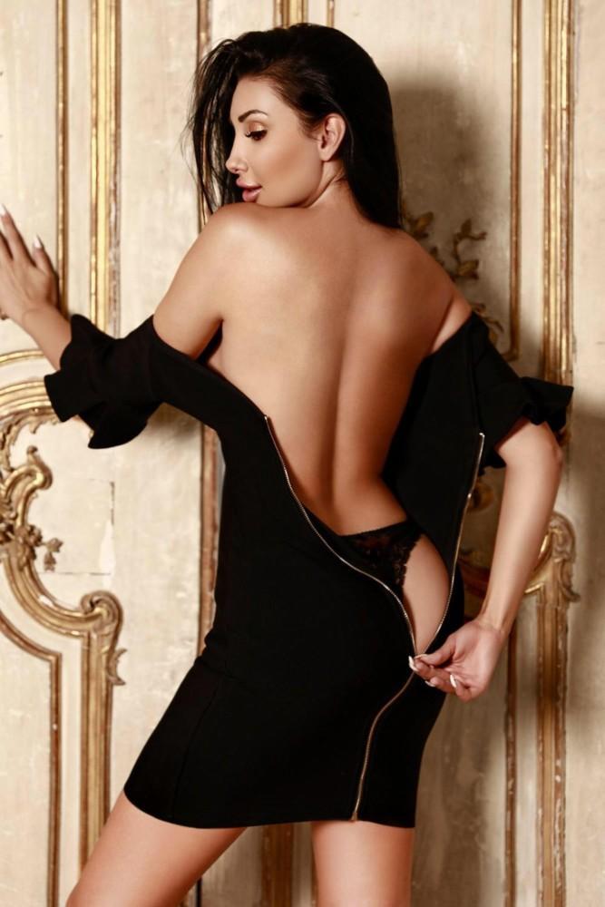 Baker Street Escort Leona Beautiful English Model. Unzipping her black cocktail dress, at 24hr London Escorts Agency