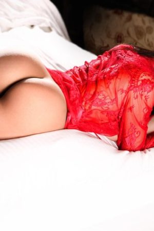 Bayswater Escort Lora Slim and Busty model. Showing her perfect peachy bum, at 24hr Lonndon Escorts Agency