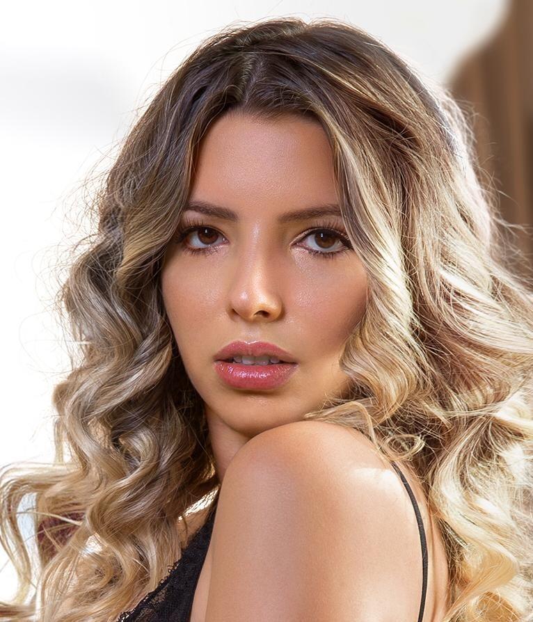 Mayfair Escort Lulu. Alluring Blonde Brazilian model. Head shot, at 24hr London Escorts Agency