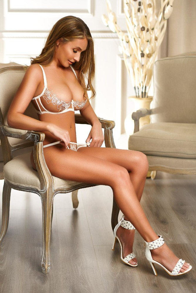 Baywater Escort Merlot stunning Busty brunette babe. Wearing see through lace lingerie, at 24hr London Escorts Agency