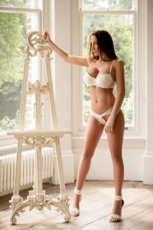 Baywater Escort Merlot stunning Busty brunette babe. Wearing white lace panties and bra, at 24hr London Escorts Agency