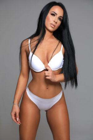 Gloucester Road escort Zenaida wearing provocative white bikini at 24hr London Escorts