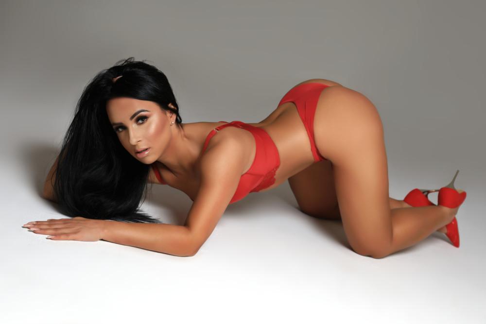 Gloucester Road escort Zenaida wearing red hot bikini at 24hr London Escorts