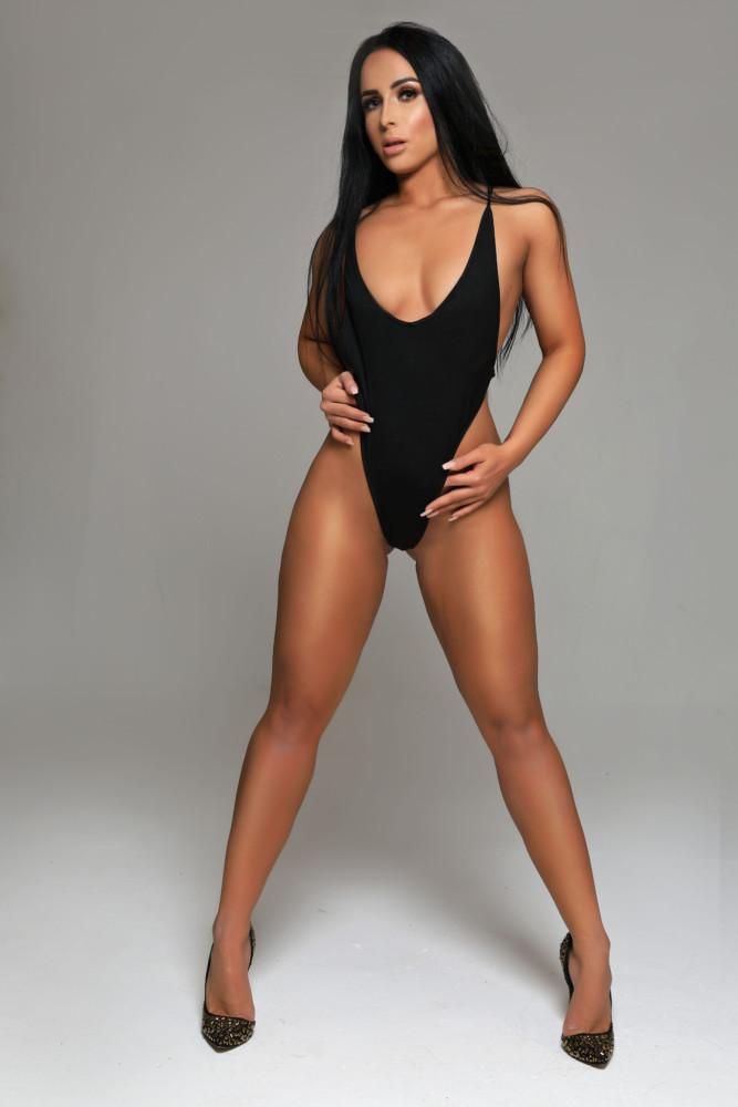 Gloucester Road escort Zenaida wearing dazzling black bathing suit at 24hr London Escorts