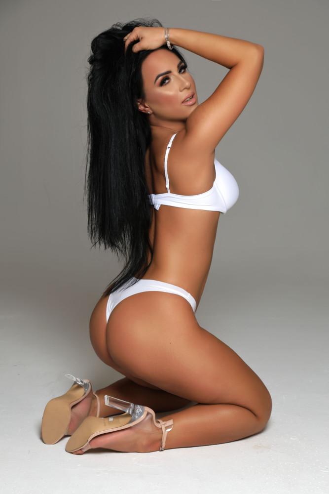 Gloucester Road escort Zenaida wearing alluring white bikini at 24hr London Escorts