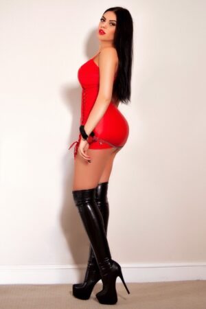 Mayfair Escort in London Anamona. Wearing BDSM Super Sexy Red Outfit at 24hr London Escorts Agency