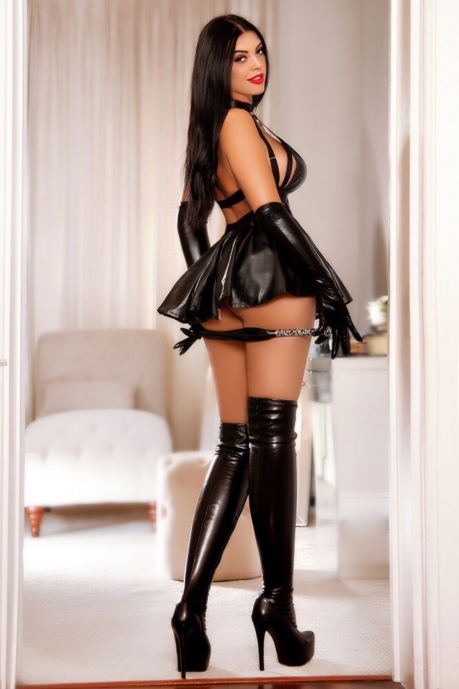 Mayfair Escort in London Anamona. Wearing BDSM Super Sexy Outfit at 24hr London Escorts Agency