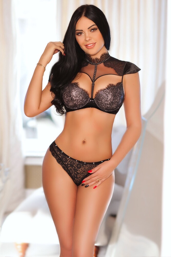 Mayfair Escort in London Anamona. Wearing BDSM Super Sexy black lace lingerie at 24hr London Escorts Agency