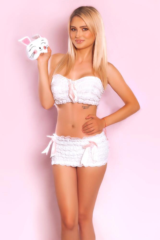 Linda Sexy 34C Busty Blonde London Escort. Wearing white, bunny oufit at 24hr London Escorts