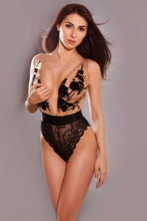 Knightsbridge Escort Kelly Slim tall and slender model. Wearing black lace lingerie, at 24hr London Escorts Agency