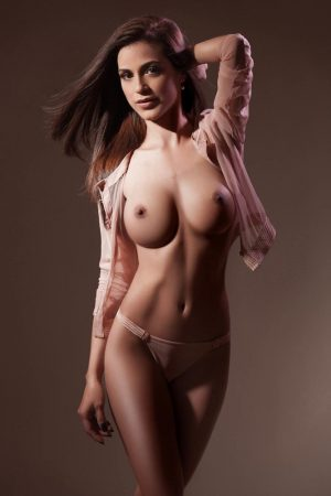 Gloucester Road Escort Cassie. Wearing sheer nude shirt and panties at 24hr London Escorts Agency