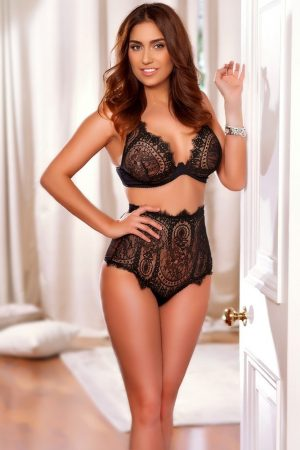Busty Knightsbridge Escort Crystal. Wearing Sexy black lace pantie & bra, bottom shoes at 24hr London Escorts Agency