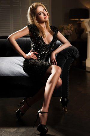Bayswater Escort Eva Slim and Slender blonde. Wearing Black sequin cocktail dress at 24hr London Escorts Agency